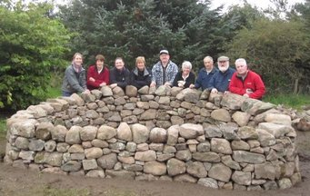 Group of volunteers at the sensory garden stone planters