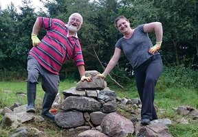 Two volunteers standing by the stone planters being build for the Balmedie Sensory garden